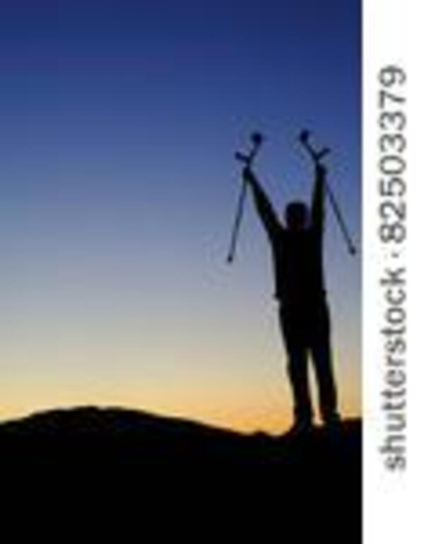 stock-photo-silhouette-of-a-man-facing-the-dawn-holding-his-crutches-high-above-his-head-greeting-the-sunrise-82503379
