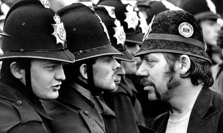 Miner-faces-police