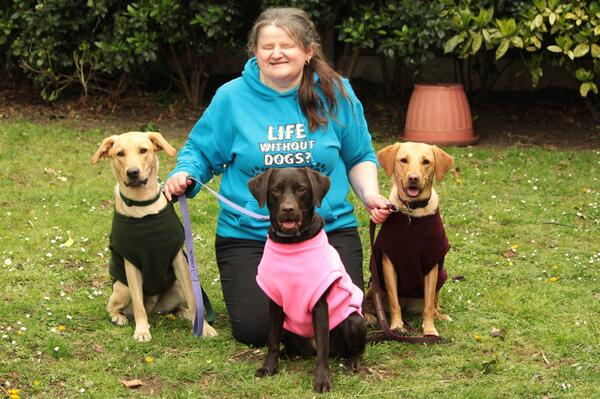 donna with all three dogs in equafleece