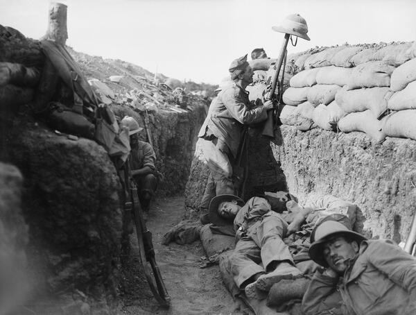 Royal Irish Fusilier gets sniper attention c IWM Q 13447