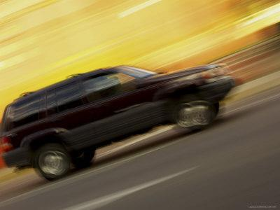 side-view-of-a-speeding-car