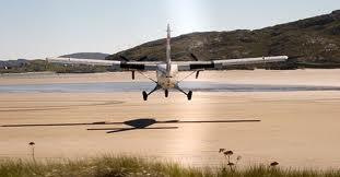 Plane landing at Barra beach