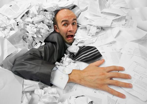 bigstock-Businessman-sinking-in-heap-of-30902069